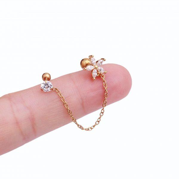 piercing perforacion oreja okami joyeria mexico queretaro con cadena flor